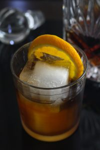Rum drink with bitters and large orange slice
