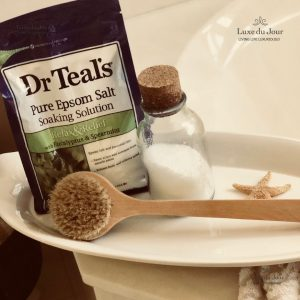 Dr. Teal's Epsom Salt container with glass jar on a tray