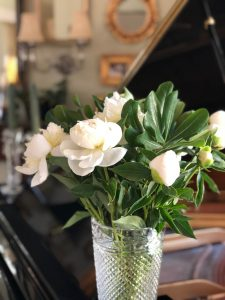 White peonies in a Ralph Lauren crystal vase. This is on the piano in our living room
