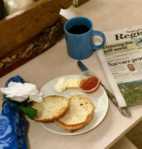 Local newspaper with English muffins and toppings on rustic table