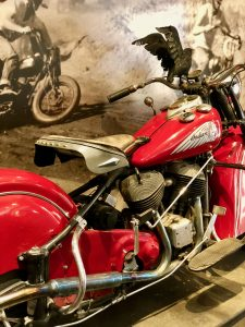 Red vintage Indian motorcycle at Tank Garage Winery