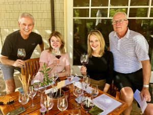 Wine tasting table on the patio at Cliff Lede with friends