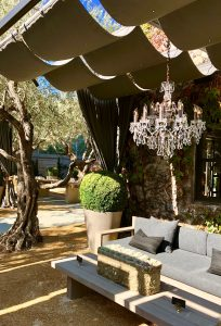 gorgeous outdoor space with chandeliers and comfy couches