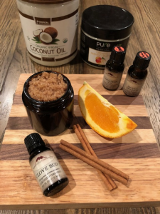 Sugar, Orange, cinnamon sticks and essential oil vials ready to make sugar scrub