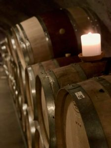 Wine barrels with lighted candles in wine cave at Pride Mountain Vineyards