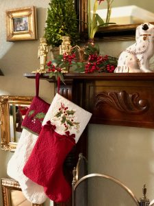 Mantle with Christmas stockings and topiary