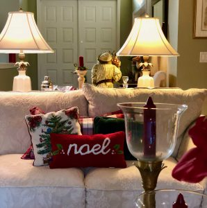 Shot of living room with Christmas pillows, candles and lamps