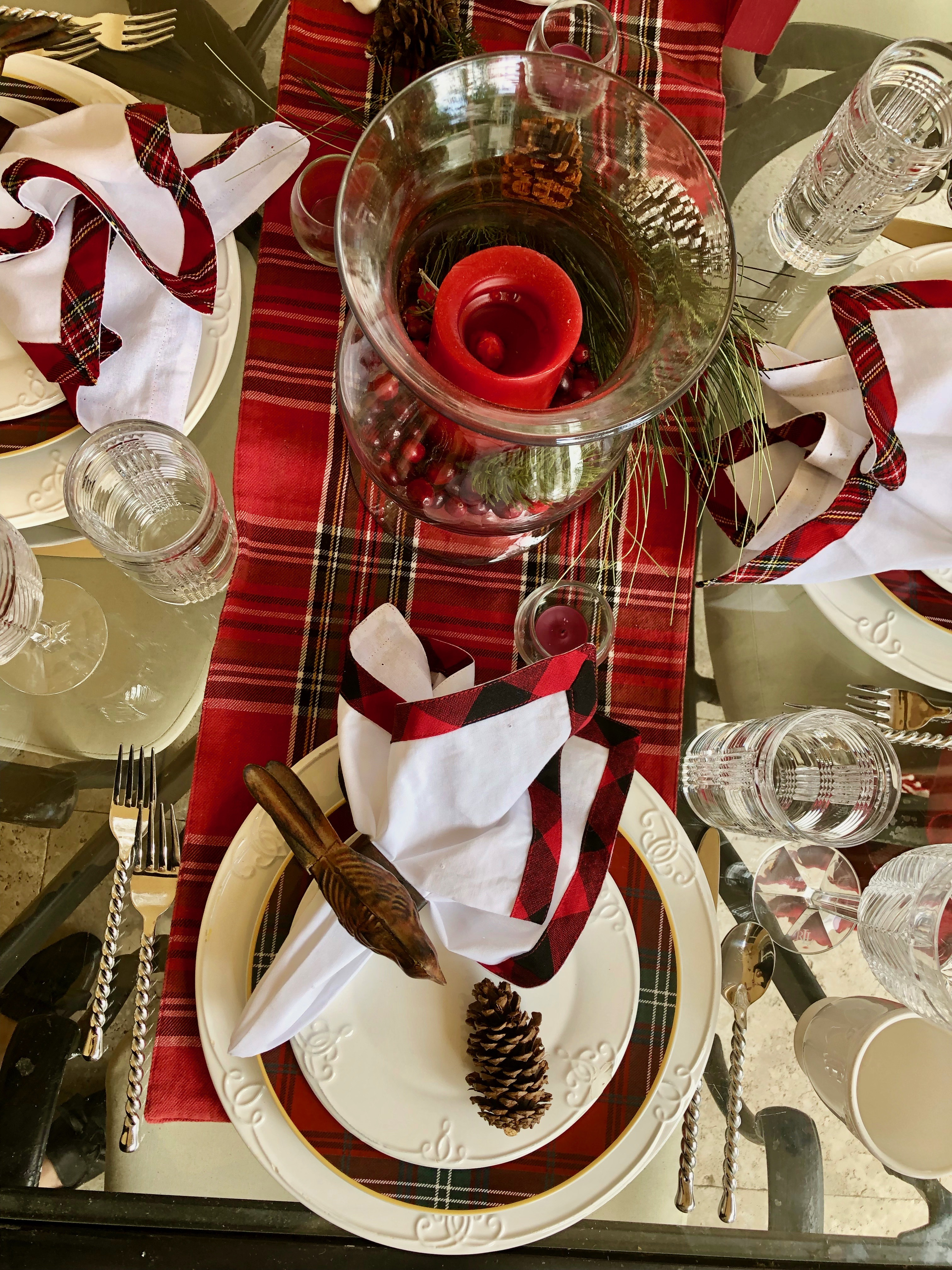 Aerial view of table setting on patio with tartan accents and Ralph Lauren crystal glasses
