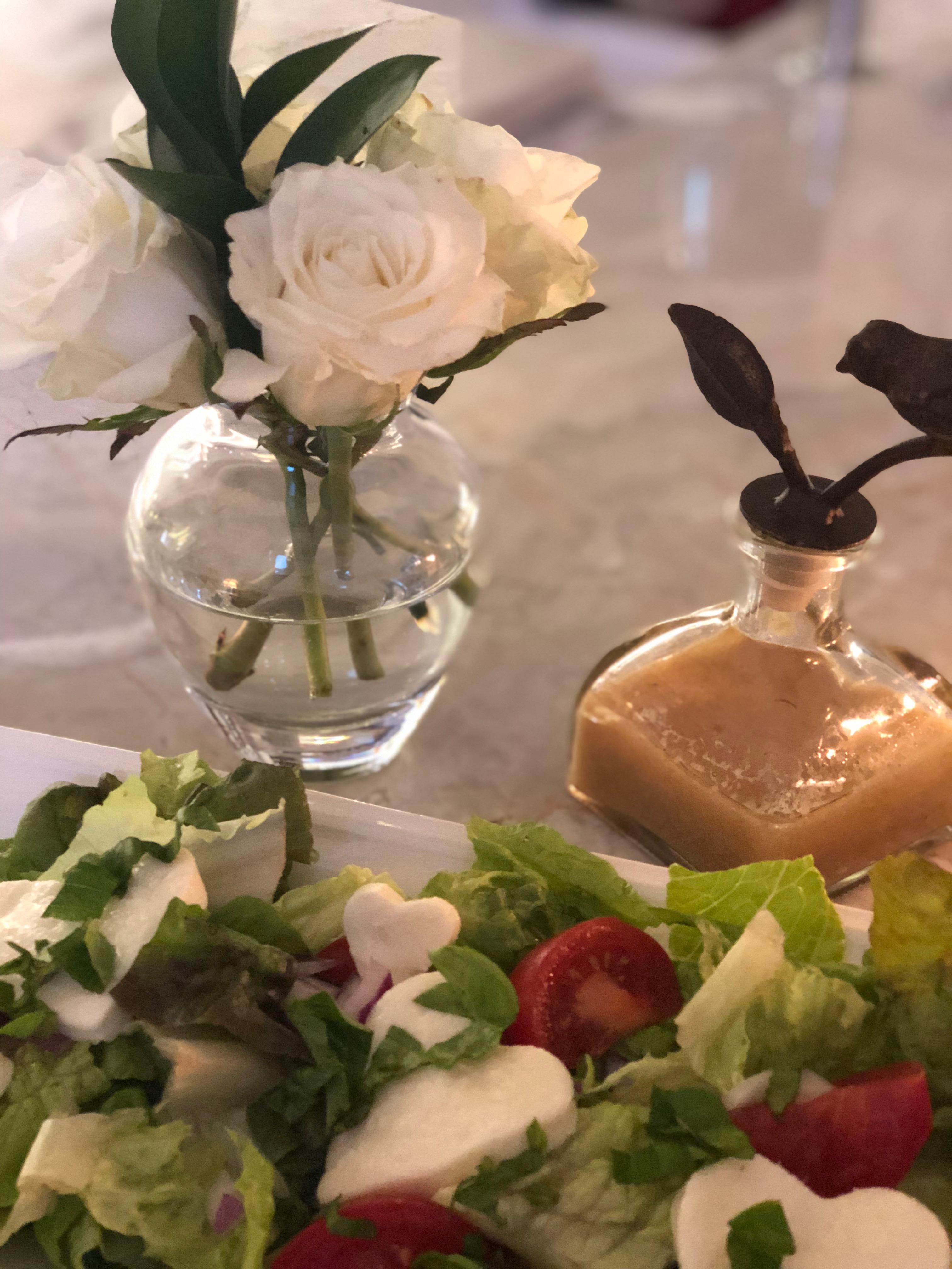 Green salad with heart shaped mozzarella, cherry tomatoes, fresh basil and homemade vinaigrette