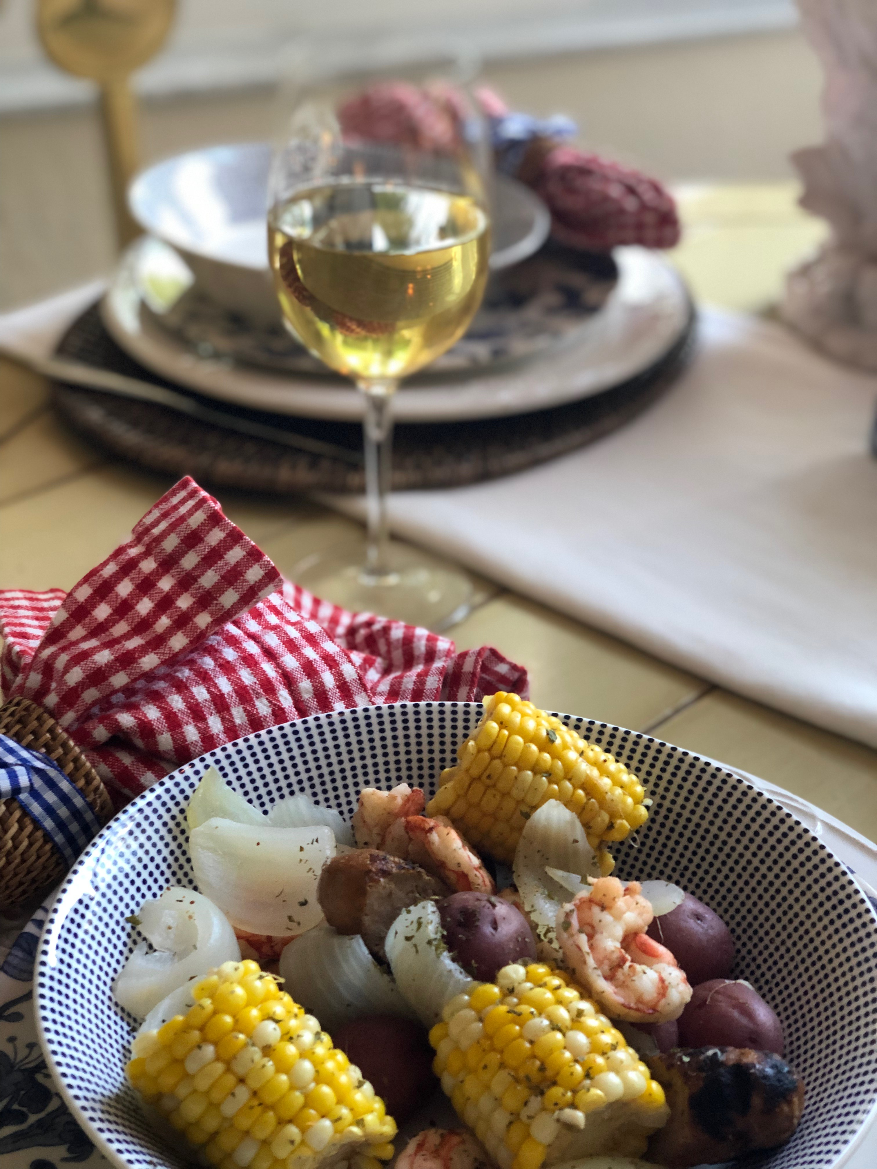 Bowl of shrimp, corn on the cob, sausage, onion and Old Bay Seasoning. Traditional Lowcountry Shrimp Boil